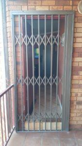 Front Door retractable security gate closed