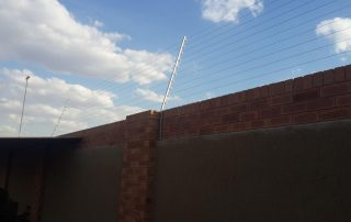 wall top electric fence east rend-2